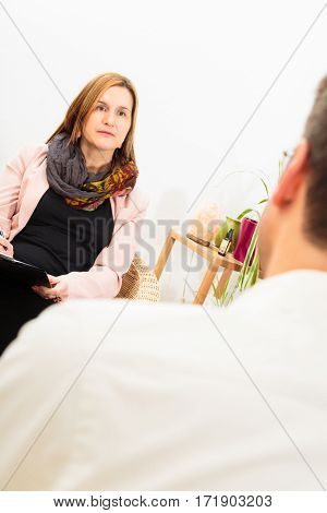 Adult man tolking to a psycho therapist