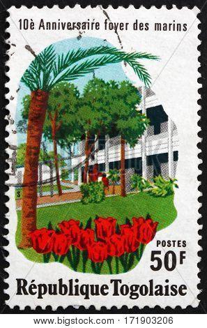 TOGO - CIRCA 1976: a stamp printed in Togo shows Marine exhibition hall circa 1976