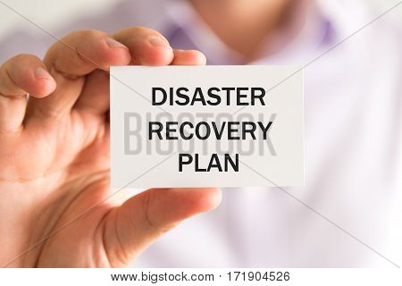 Businessman Holding Disaster Recovery Plan Card