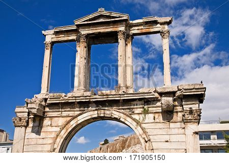 Arch of Hadrian, with the Acropolis in the background, in Athens, Greece.