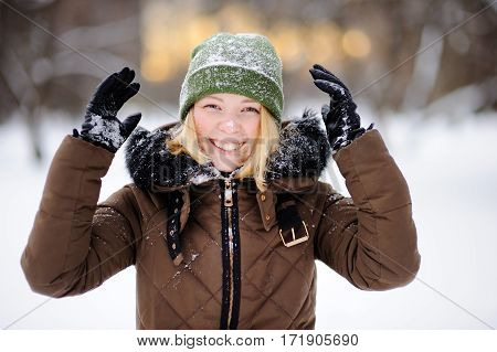 Young Beautiful Woman Having Fun In Winter. Active Game With Snow