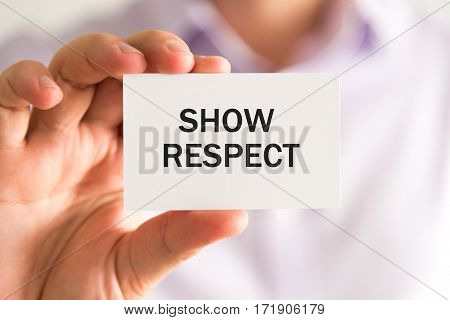 Businessman Holding A Card With Text Show Respect