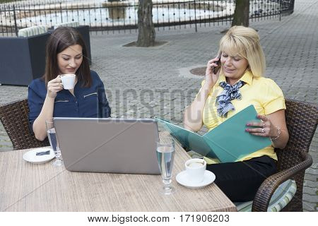 Senior and young business woman on coffee break Selective focus and small depth of field