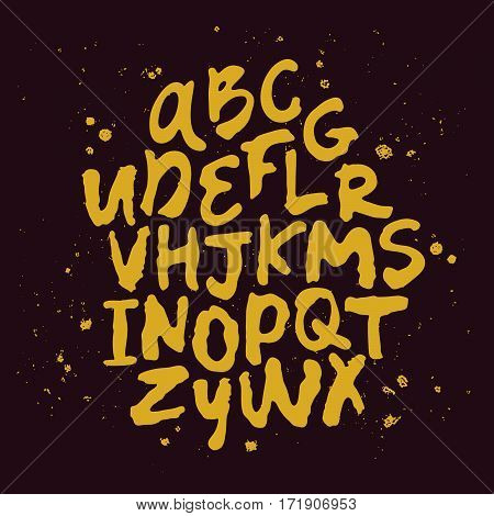 Vector alphabet. Hand drawn letters. Gold on a black background.