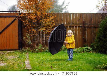 Little Boy Walking At Rainy Cloudy Autumn Weather