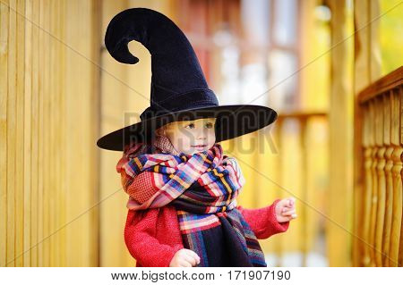 Toddler Boy In Pointed Hat Playing Outdoors