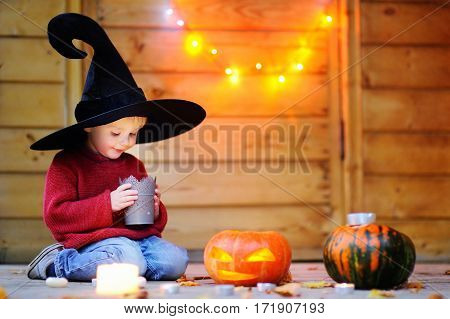 Little Wizard Looking On Candle. Halloween Concept
