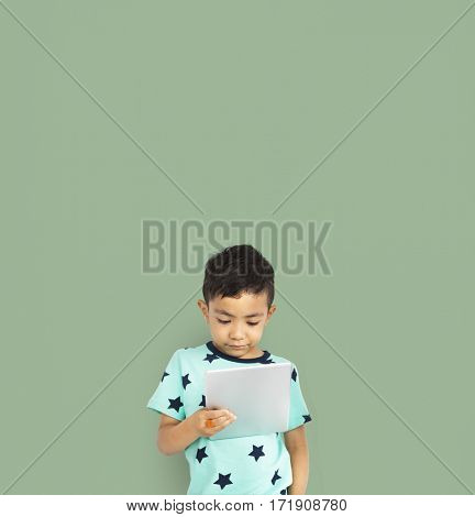 Little boy studio isolated with tablet