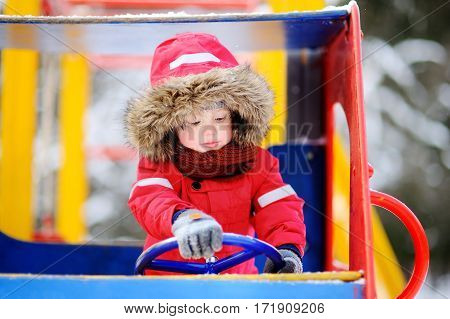 Cute Little Boy Having Fun On Playground