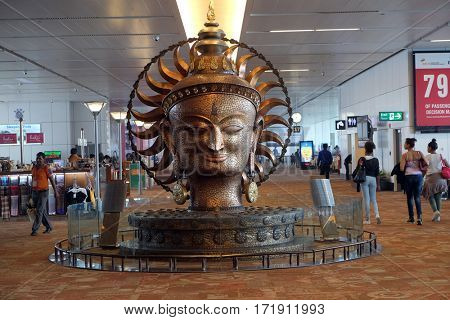 DELHI, INDIA - FEBRUARY 19: Surya, the resplendent one by Satish Gupta, golden statue in international Airport of Delhi on February 19, 2016. Indira Gandhi Airport is the 32th busiest in the world.