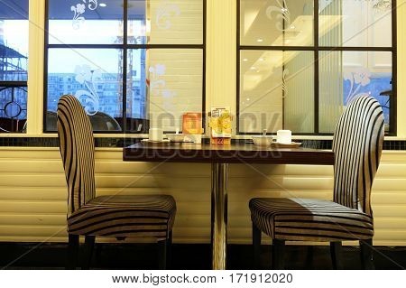 BEIJING - FEBRUARY 25: Dinning table and chairs in restaurant, Beijing, China, February 25, 2016.