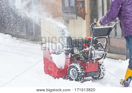 Close up of snow removal machine working on the street takayama Japan.