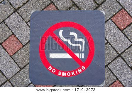Close up of no smoking sign on the ground in Japan.