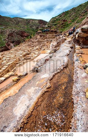 The water stream in Minas de Sal de Maras the salt mines in Maras Cusco Peru
