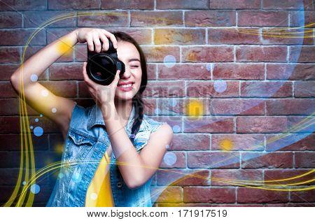 Professional photographer on brick wall background. Creative design