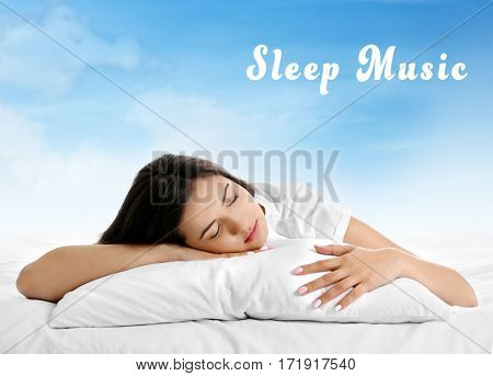 Concept of music for sleep and meditation. Young woman sleeping in bed and sky background