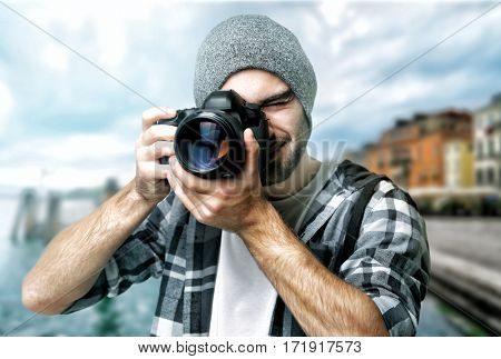 Photographer taking picture of beautiful cityscape