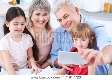 Grand parents with little girls taking selfie