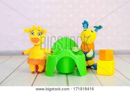 Green potty on home interior background. childhood. hygiene. habit