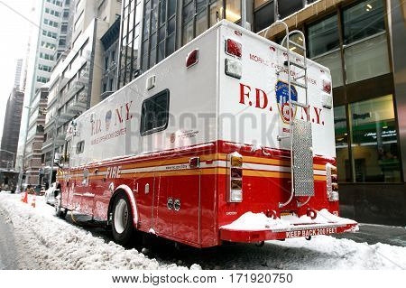 New York February 9 2017: An FDNY mobile operations center is parked in the snow in midtown Manhattan.
