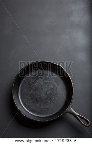 Cast Iron Skillet with copy area on black background