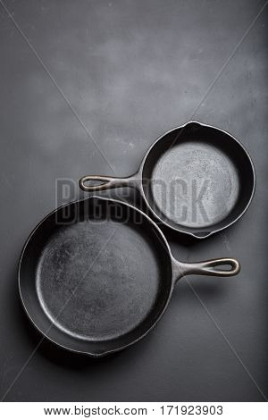 Two Cast iron skillet collection on black background with copy area