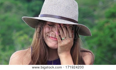 A Tearful Teen Girl Wearing a Hat