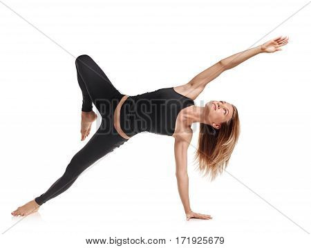 Slim graceful woman doing gymnastic exercises on white background