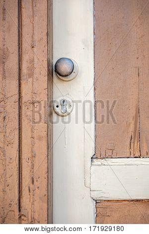 Details of old wooden door with door nob in old wall sunset in Tel Aviv, Israel.