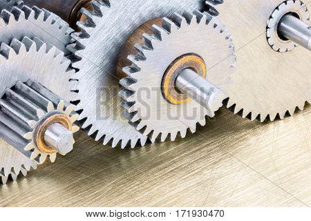 Mechanical Gear Cogwheels On Scratched Brass Background