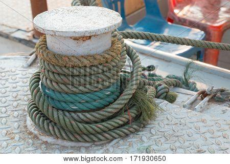 Ship hemp cable bound over a mooring bollard