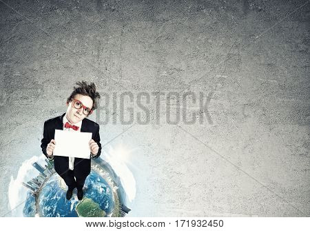 Top view of funny businessman in red glasses showing blank paper sheet. Elements of this image are furnished by NASA
