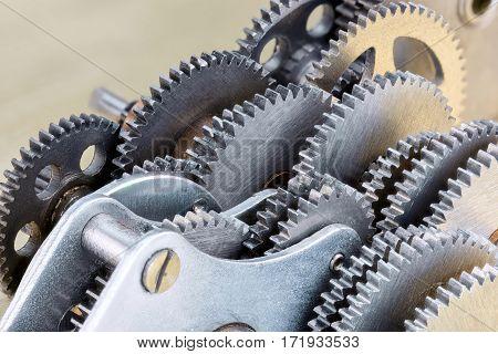 Gearwheels As Machinery Details. Industrial Mechanism Closeup.