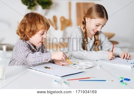This will be legendary. Lively passionate charming children having fun painting things using watercolors while spending the weekend together