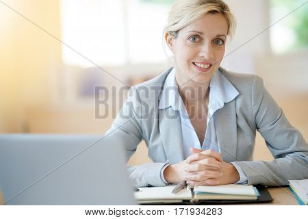 Businesswoman working in office on agenda