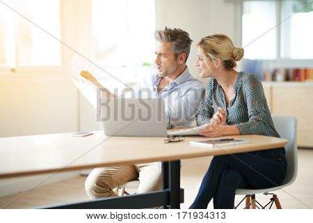 Business team working together on project in office