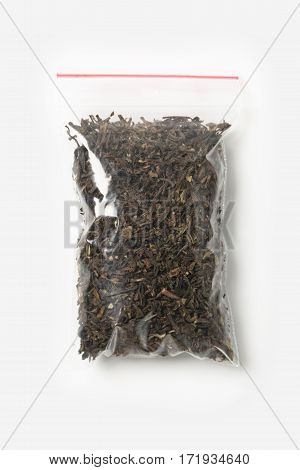 Plastic Transparent Zipper Bag With Full Of Dried Darjeeling Black Tea Isolated On White, Vacuum Pac