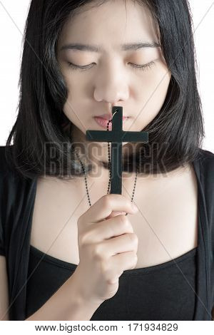 Beautiful Asia Woman With Hopeful Holding Christian Symbol Of Crucifix Praying To God Isolated On Wh
