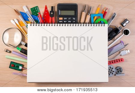 Notebook Over School Supplies Or Office Supplies On School Table. Background With School Or Office M