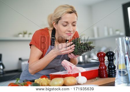 Woman in kitchen cooking dish for dinner