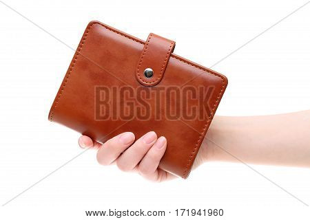 Hand holding brown leather notebook isolated on white background