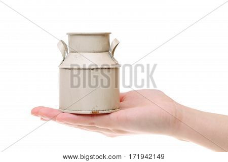 vintage milk can on the hand isolated on white