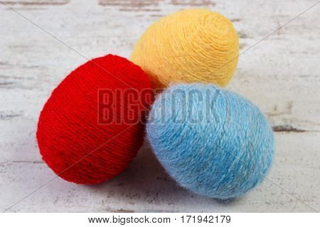 Easter Eggs Wrapped Woolen String On Wooden Background, Decoration For Easter