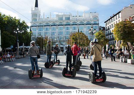MADRID SPAIN - OCTOBER 30 2013: Tourists sightseeing on segway tour of Madrid on Plaza de Santa Ana