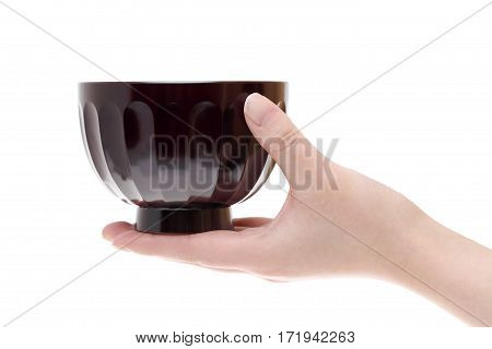 hand hold japanese soup bowl isolated on white background