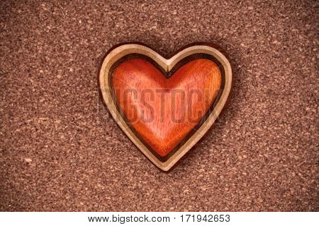 One wooden heart on rustic wood background. Valentines days concept.  Love symbol. Greeting card.