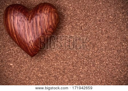 One wooden heart on rustic wood background. Valentines days concept.  Love symbol. Greeting card with copy space.