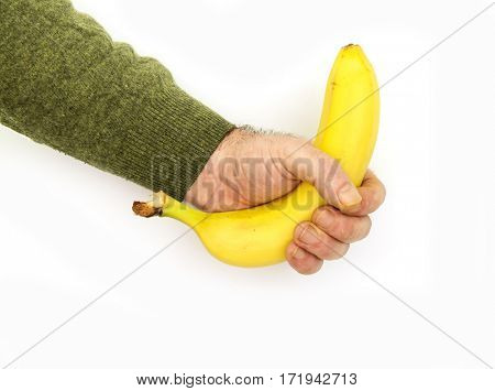 Banana in a man's hand on a white background