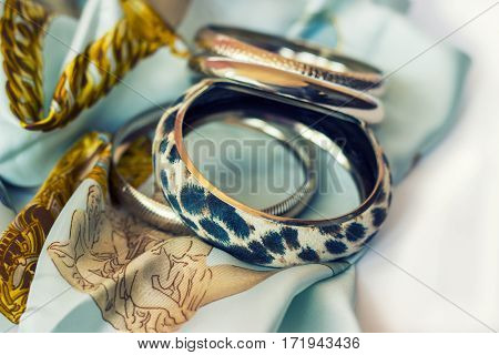 Leopard bracelet on silk scarf; fashion accessories