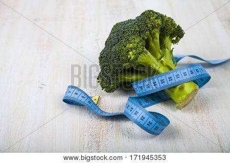 Broccoli And Measuring Tape On A Table Close-up.